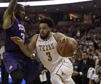 At half way point of season, what do Big 12 officials, Shaka Smart think about the rule changes?