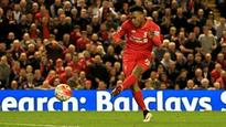 Daniel Sturridge is trying to claim Philippe Coutinho's goal against Everton