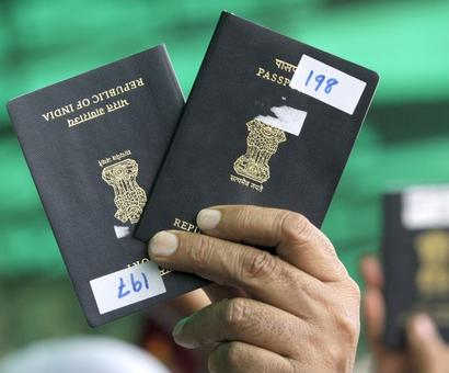 Rahul sees red over government's orange passport plan
