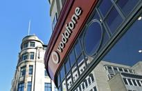 RPT-UPDATE 2-Vodafone takes $5 bln charge against new price war in India