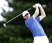 Golf-Walker back on happy hunting ground in Hawaii