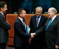 Euro ministers urge troubled Slovenia to act