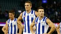 North Melbourne's Brent Harvey may be in trouble for high contact on Sam Mitchell