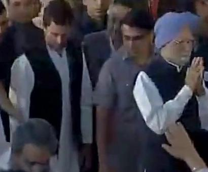Rahul, Dr Singh at swearing in
