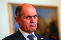 Italy says Austria 'wasting money' in migrant ... New Austrian Interior Minister Wolfgang Sobotka listens to a reporter questi...