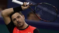 US Open champion Wawrinka stunned; Djokovic, Murray win