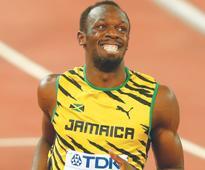 Bolt undergoing treatment for hamstring tweak