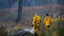 Firefighters battle brush fire in Haifa neighborhood