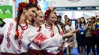 Performers dance at the Belarus pavilion during the 5th China-Eurasia Expo in Urumqi