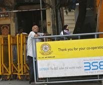 Sensex, Nifty remain in positive territory; UltraTech Cement up on strong volumes