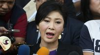 Former Thailand PM Yingluck Shinawatra tells junta chief to probe his own brother
