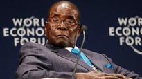 Slumped and mumbling, 93-year-old Robert Mugabe denies Zimbabwe is 'fragile'