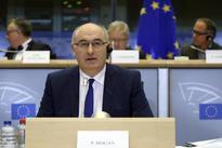 Hard Irish border likely in hard Brexit, EU's Hogan says - report