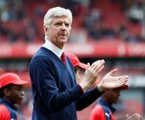 Arsene Wenger is 'reluctant' to open up the club chequebook