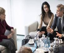 Clooney hosted by Merkel for talks on refugee policy