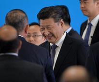 China not limiting criticism, President Xi says, wants everyone on same song sheet