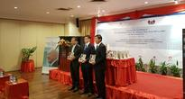 Translated copy of Lee Kuan Yew's From Third World to First launches in Laos