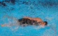 Missy Franklin cut it close but qualifies for finals of 100-meter backstroke at Olympic Trials
