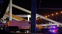 At least 4 killed, 8 injured after newly built pedestrian bridge collapses near Florida International University