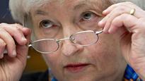 US rate strategists slash forecasts