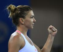 Halep books place in WTA Finals at Wuhan