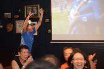 Diehard Singaporean Leicester fan stands out in a sea of red
