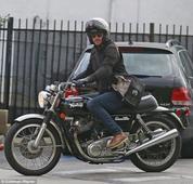 Keanu Reeves ride off on vintage motorcycle