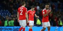 Fans wear poppies, Fifa to punish Wales