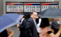 Asia stocks resilient, dollar up before Yellen, Draghi speeches