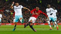 Winston Reid kicks Wayne Rooney in the face in Manchester United win over West Ham