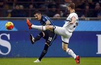 Inter win to claim top spot, struggling Roma held