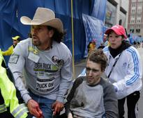 Cowboy-hat hero meets with bomb victim he rescued