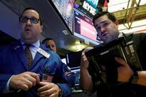Tech propels Wall Street as Nasdaq sets record