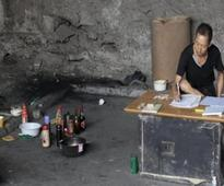 Chinese Man Lives Under Bridge for 10 Years to 'Crack Lottery Code&#8217