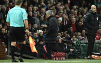 Mourinho sent off on bad day for United as Arsenal win again