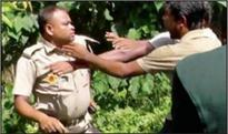 Cop attacked over garbage dumping