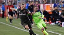 Origi, Firmino score as Liverpool tops Milan in ICC friendly