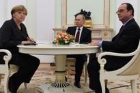 Russia accused of war crimes as Putin, Merkel, Hollande talk Syria