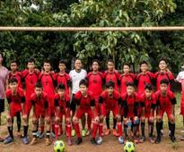 Street side: Indonesia slum kids eye youth World Cup
