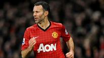Giggs revels in title No.13