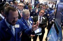 Tech, bank stocks lift S&P, Nasdaq; IBM holds back Dow