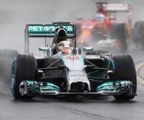 Hamilton snatches Aussie pole as Vettel flops