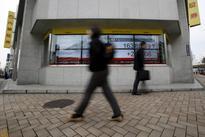 Asian shares slip, U.S. presidential debate awaited