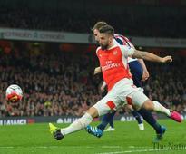 Sanchez sinks West Brom to settle Arsenal nerves