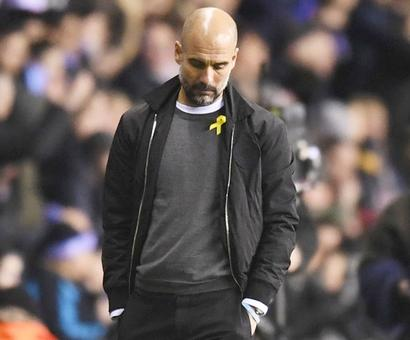 FA charges Guardiola for wearing Catalan support ribbon