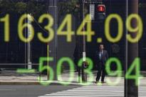 Asian shares look set to advance, oil prices eye $50
