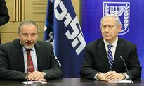 Deal signed to expand Israel's governing coalition / Lieberman to become defense minister