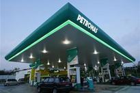 Malaysia's Petronas warns of further oil price impact as profit hit