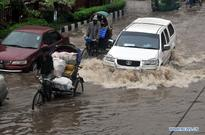 Heavy showers hit Dhaka, Bangladesh