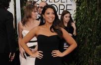 Gina Rodriguez loans Golden Globes dress to a fan